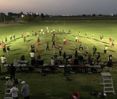 The Enochs Marching Band and Color Guard practicing for their first show.